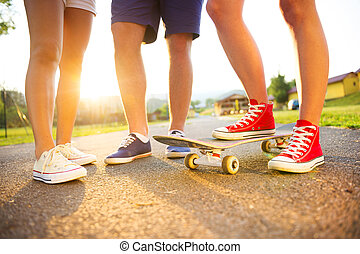 Young peoples legs with skateboard