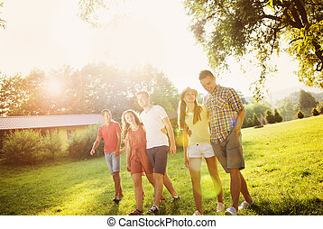 Friends having fun in park - Group of six teenage friends...