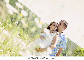 Pregnant couple - Happy young pregnant couple hugging in...