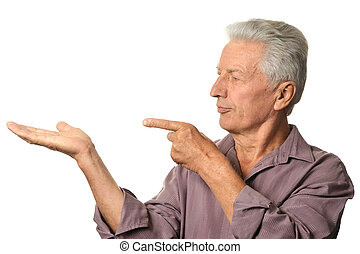 Mature man pointing with his fingers on a white background