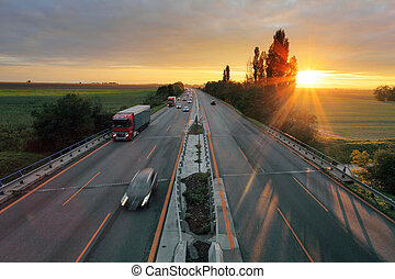 Highway with car at sunset