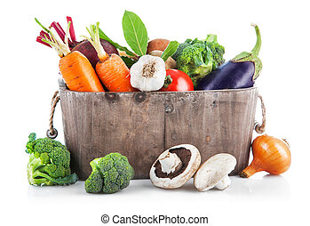 Harvest vegetables in wooden basket