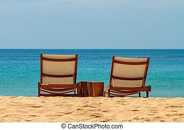 empty sunbeds on a gorgeous sandy beach
