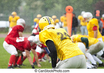 American football match - American football game in rain