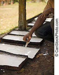 rubber  - milk latex procees to raw rubber sheets