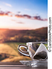 Morning cup of tea with view - Glass cup and saucer with...