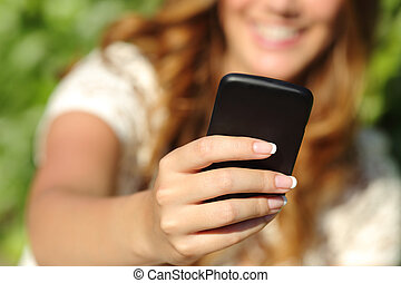 Close up of a happy woman hand using a smart phone with a...