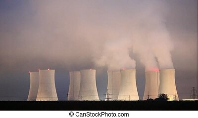 Nuclear power plant by night - Time lapse