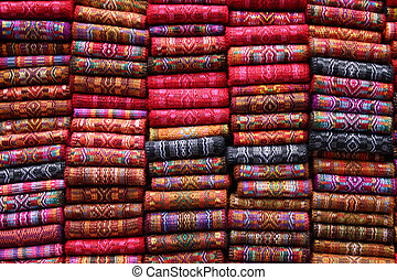 Woven Belts at the Market - Woven wool belts in a variety of...