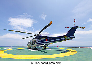 helicopter parking landing on offshore platform. Helicopter...