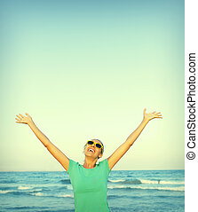 Freedom - Woman pulls hands to the sky. Freedom - conceptual...