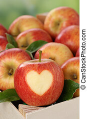 Apple with heart in a box in autumn love topic - An apple...