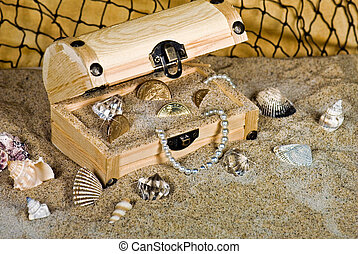 Buried Treasure - Beads, coins and baubles in a wooden...