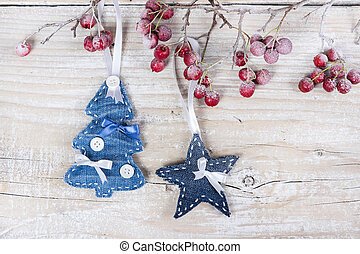 Christmas trees and stars on a branch with berries -...