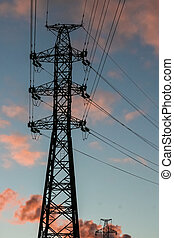 Powerlines in the sunset - The silhouette of the power tower...