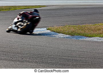 Motorcycle racing - Motorcycle rider exiting a corner Motion...