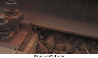 rusty bolt on the rail