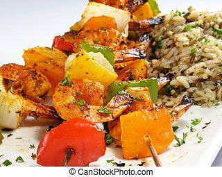 Shrimp Kebabs and Rice - Spicy shrimp kebabs with colorful...
