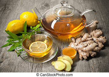 Ginger tea - Cup of ginger tea with honey and lemon on...