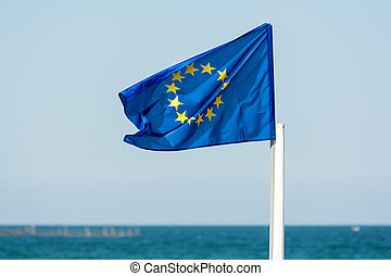 European Union Flag With Blue Sea Background