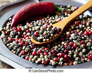 Peppercorns - Colorful Peppercorns in a Wooden Spoon,...