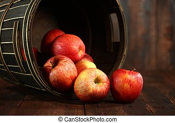 Red Apples on Wood Grunge Background - Rustic Barrel Full of...