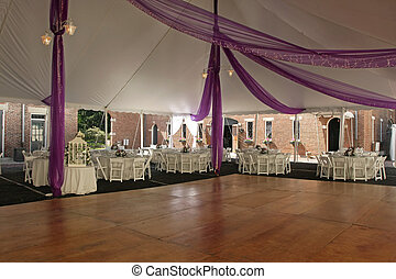 Dance Floor under tent for outdoor wedding.