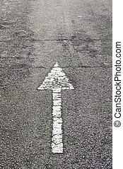 Arrow direction on asphalt, detail of an arrow of indexation...