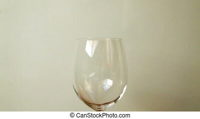 large glass of red wine on dark background