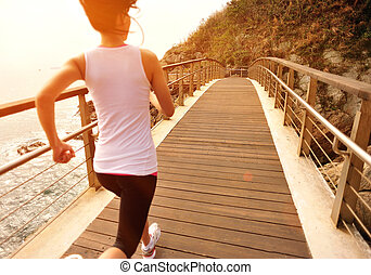 healthy lifestyle sports woman ru - woman running seaside...