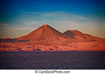 volcanoes Licancabur and Juriques, Chile - sunset over...
