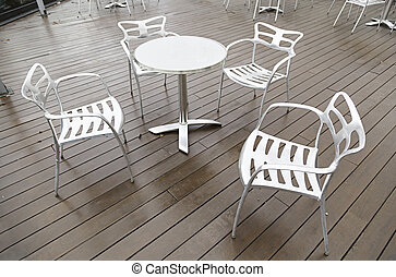 Metal chairs and table on a terrace