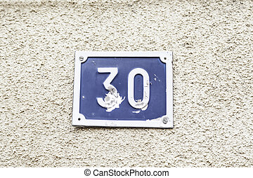 Number thirty on a wall