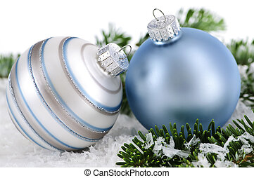 Christmas ornaments - Two Christmas decorations in snow with...