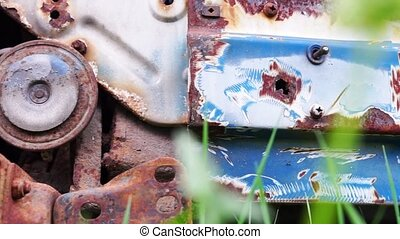 Scrapyard with close up view at car parts - Old and rusty...