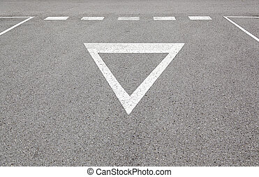 Give way sign on asphalt
