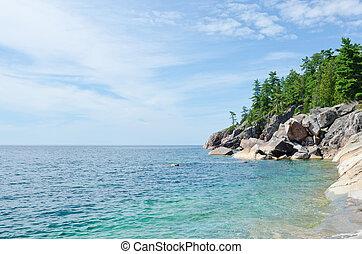 Shore of Superior Lake at summer day