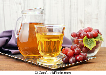 Grape Juice - Glass of Grape Juice with fresh berries on the...