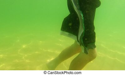 Boy swimming underwater at beach - Swimming and playing...
