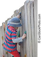 kid climbing - little boy climbing the wall at kids...