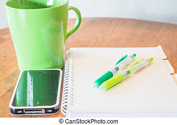 Creative work table with hot mug, stock photo