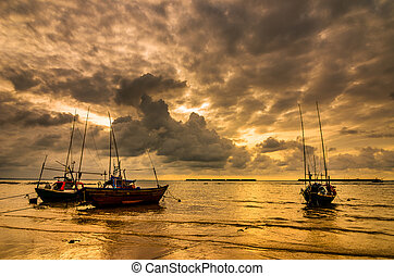 Fishing sea boat and Sunrise clouds before strom in Thailand...