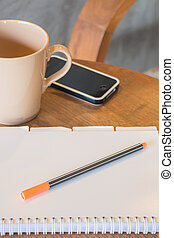 Classic wooden work station with smart phone, stock photo