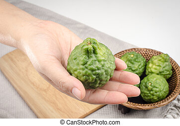 Bergamot - Image of bergamot in woman's hand on background