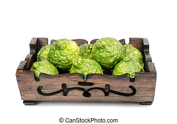 Bergamot - Image of bergamot in wooden tray on white...