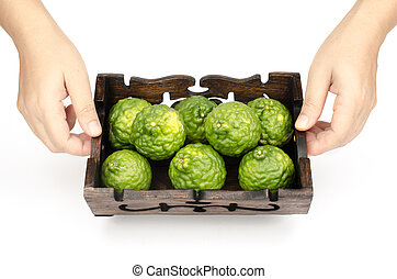 Bergamot - Image of bergamot in wooden tray with woman's...