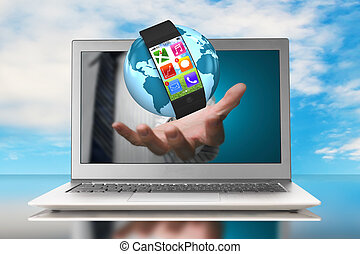 smartwatch and globe in hand through laptop with nature sky