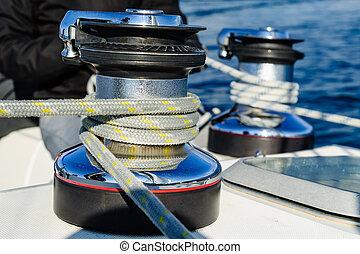 Winches with mainsail and genoa sheet ropes. - Sailing boat...