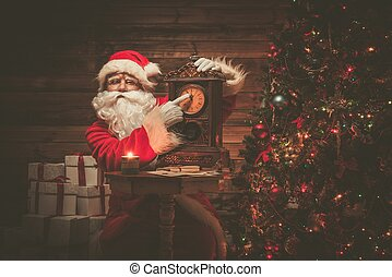 Santa Claus in wooden home interior showing time on a clock