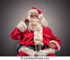 Santa Claus receives requests via telephone - Santa Claus...